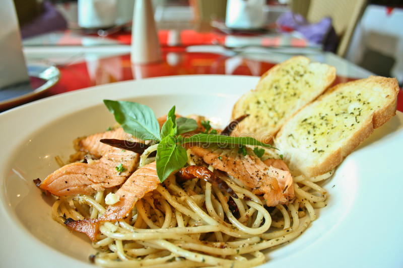 Spaghetti salmon and black pepper stock photos