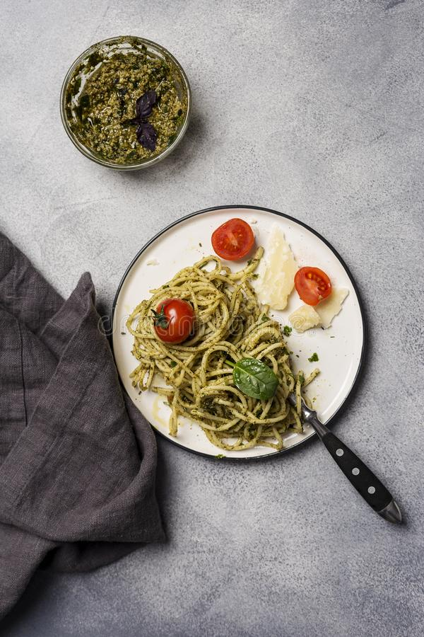 Spaghetti with sauce pesto with cherry tomatoes stock image
