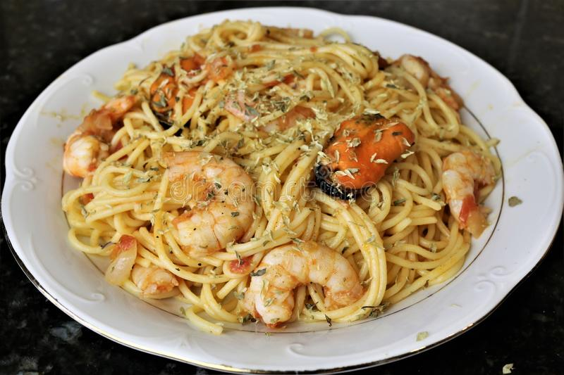 Spaghetti with seafood popular food in restaurants stock image