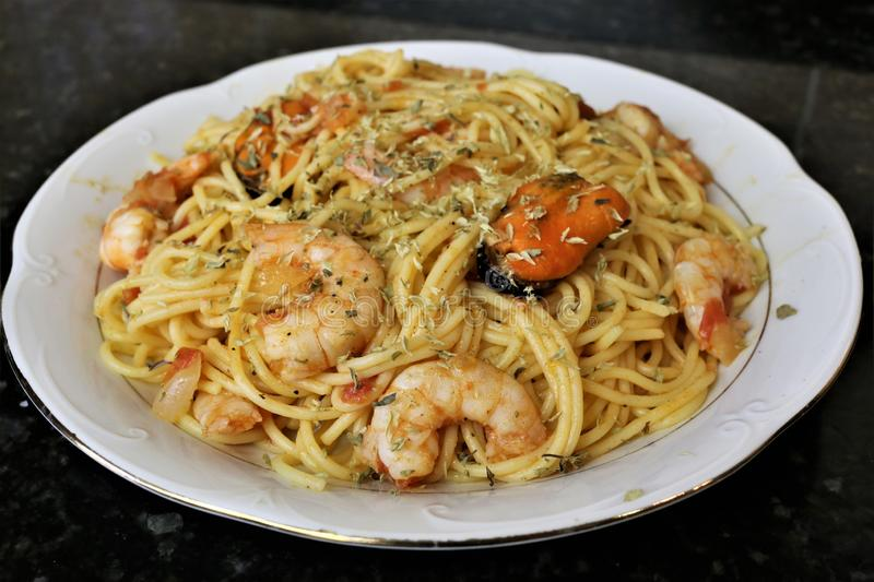 Spaghetti with seafood popular food in restaurants stock images