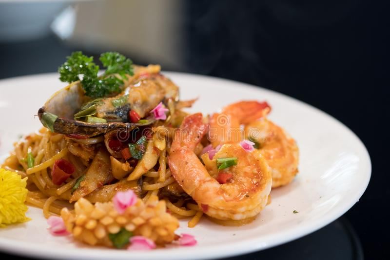 Spaghetti with seafood with shrimps and mussel royalty free stock images