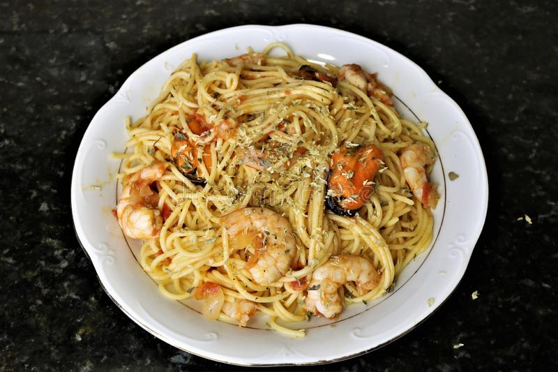 Spaghetti with seafood popular food in restaurants. Spaghetti with seafood such as prawns and mussels is a popular food in restaurants. It`s a pasta recipe with stock photos