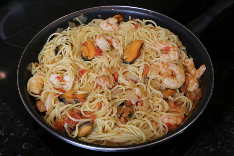 Spaghetti with seafood popular food in restaurants stock photography