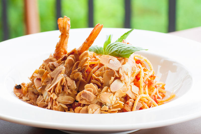 Spaghetti shrimp coated in almond seeds. royalty free stock image