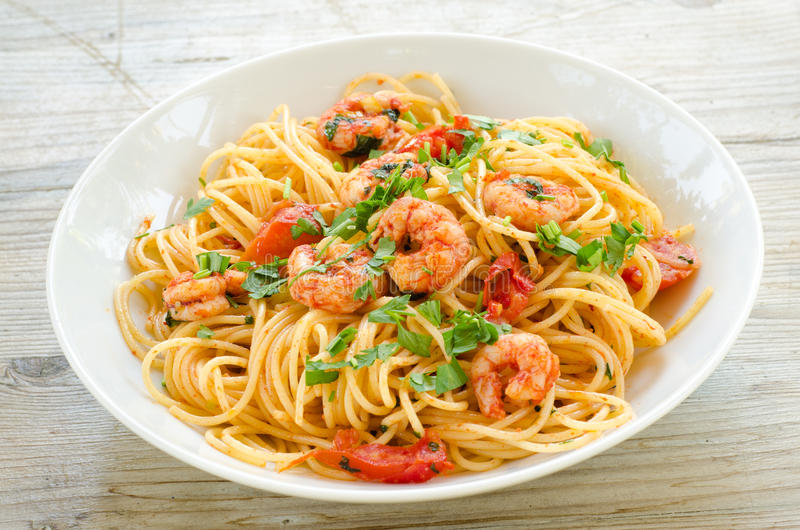 Spaghetti with shrimps and parsley stock photography