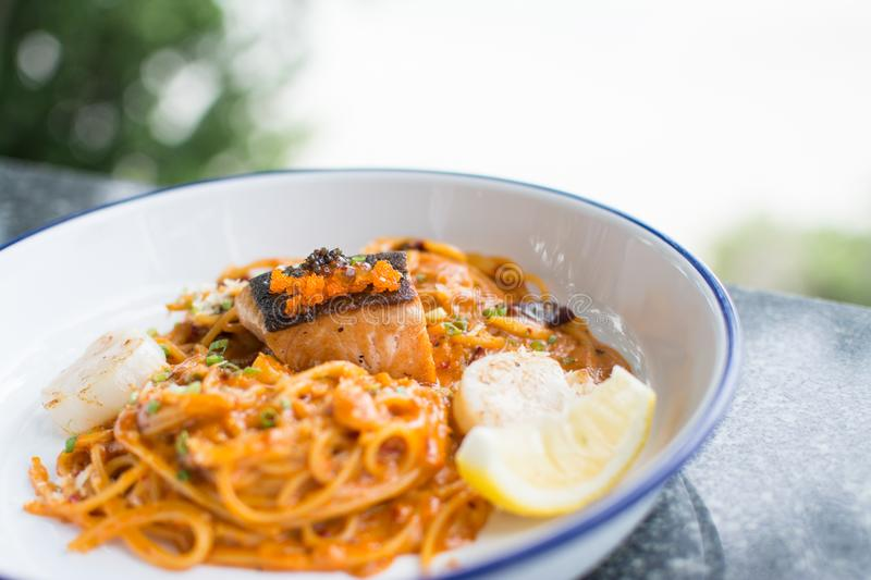 Spaghetti with smoked salmon royalty free stock photo