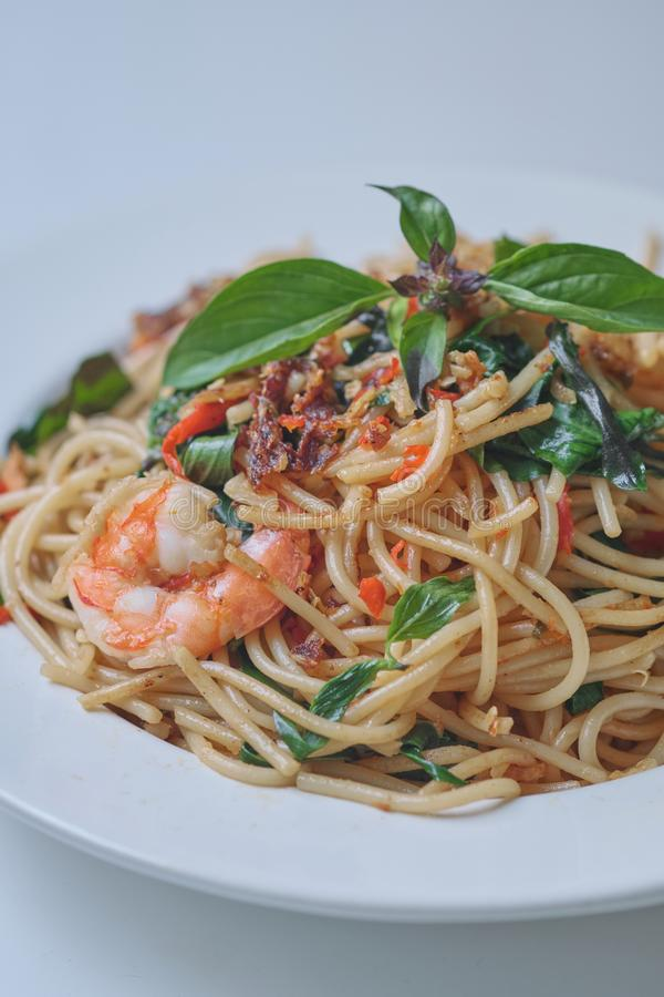 Spaghetti with Spicy Mixed Seafood Thai Style. On white plate royalty free stock photography