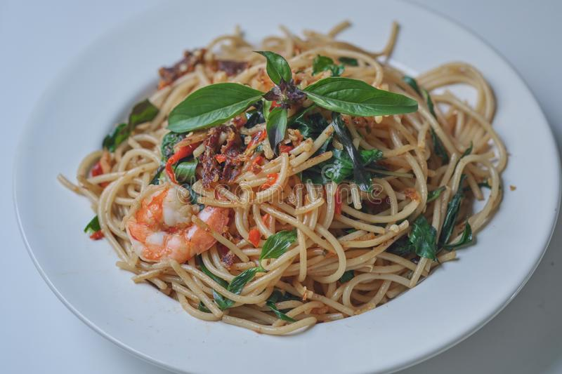 Spaghetti with Spicy Mixed Seafood Thai Style. On white plate royalty free stock image