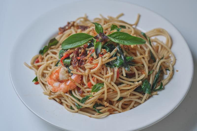 Spaghetti with Spicy Mixed Seafood Thai Style. On white plate stock image