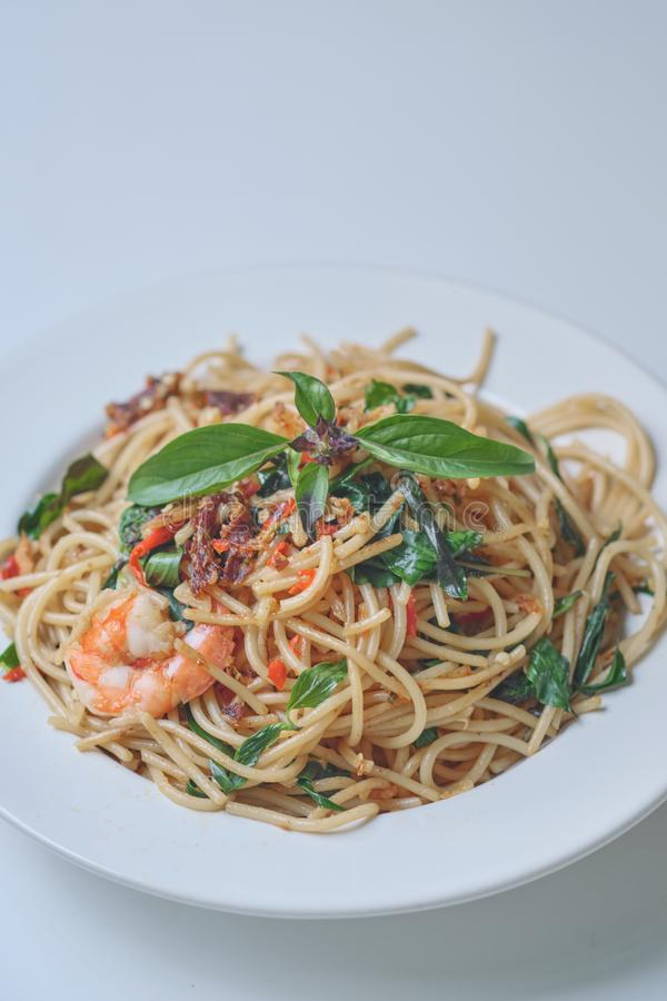 Spaghetti with Spicy Mixed Seafood Thai Style. On white plate royalty free stock photos