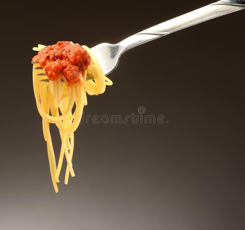 Spaghetti su una forcella immagini stock