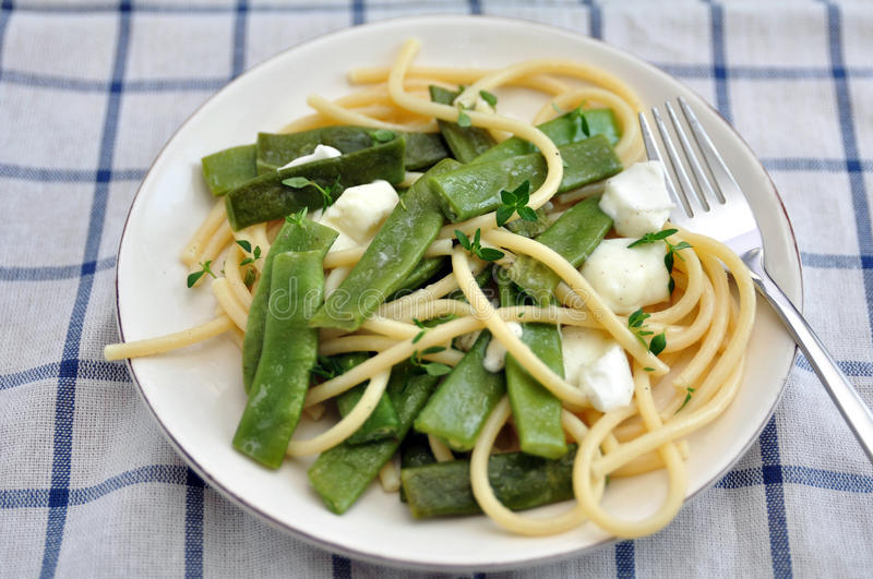 Spaghetti with sugar snap peas stock photo