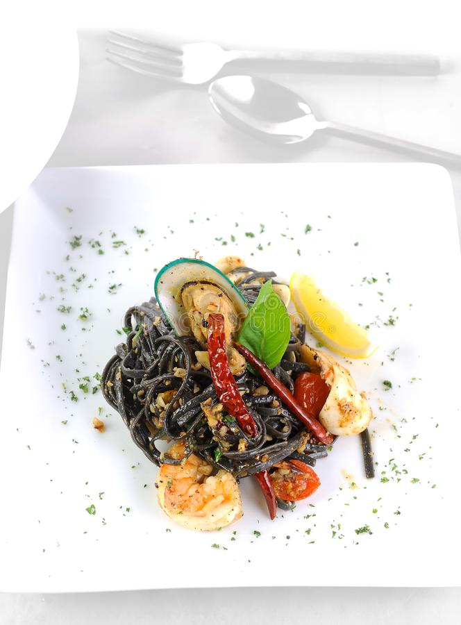 Spaghetti with Tiger Prawns stock images