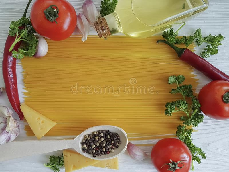 Spaghetti, tomato, garlic, pepper dinner kitchen cheese menu on a white wooden background, cooking. Spaghetti, tomato, garlic, cheese on a white wooden stock image
