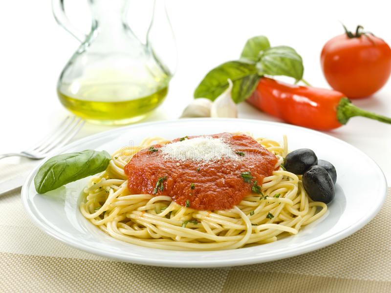 Spaghetti with tomato sauce. And olives and basil stock photo