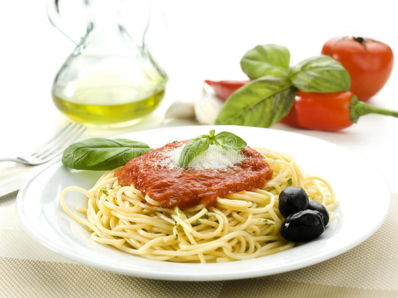 Spaghetti with tomato sauce. And basil and olives royalty free stock images