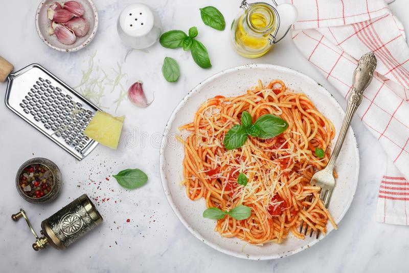 Spaghetti with tomato sauce with garlic, Basil, spices, olive oil and Parmesan cheese stock image