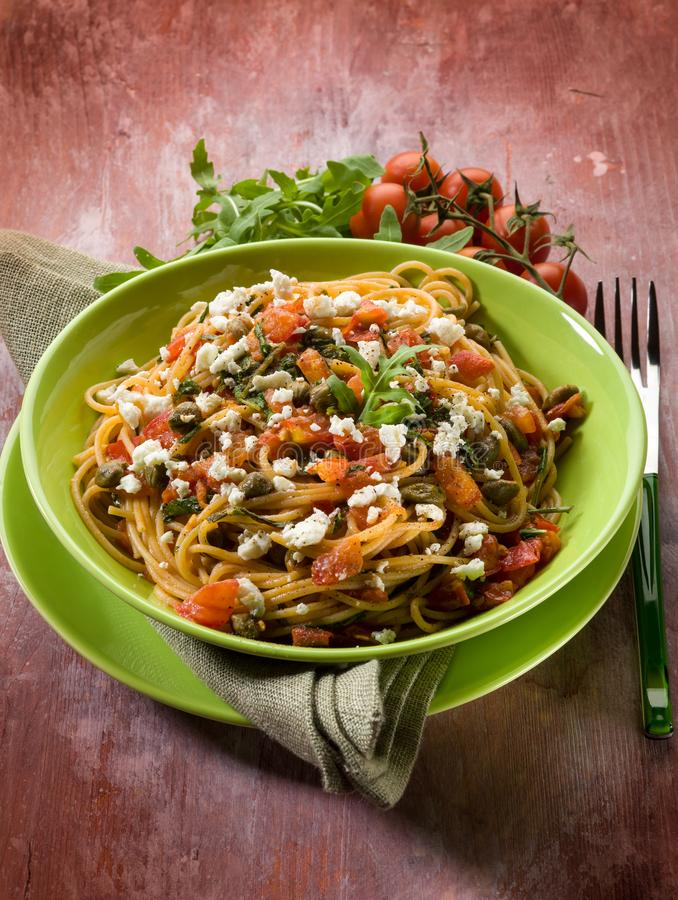 Spaghetti with tomatoes cheese and arugula stock image