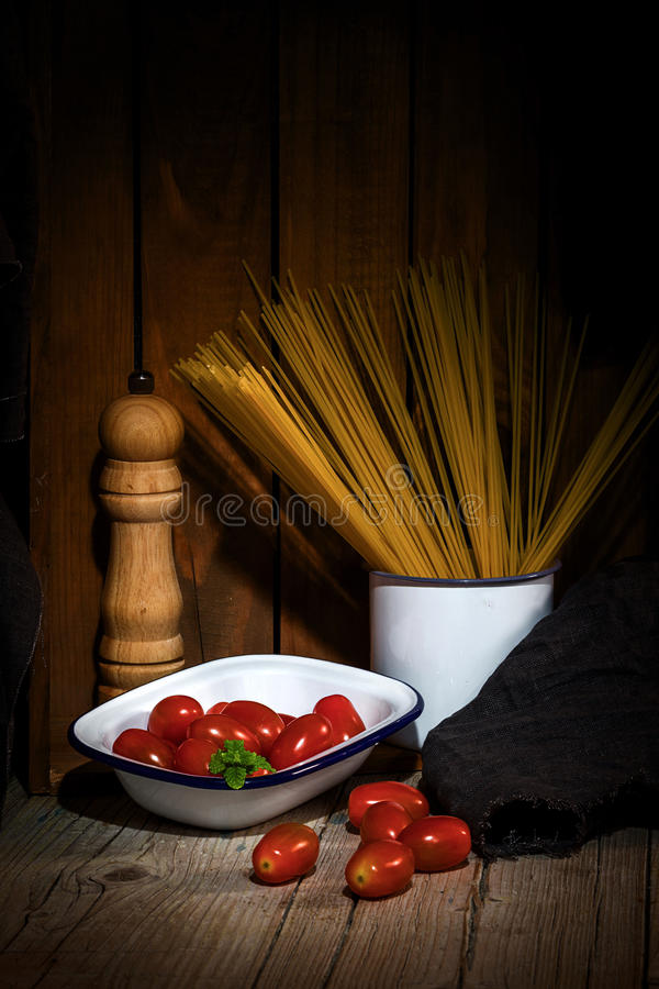 Spaghetti and tomatoes with herbs royalty free stock image