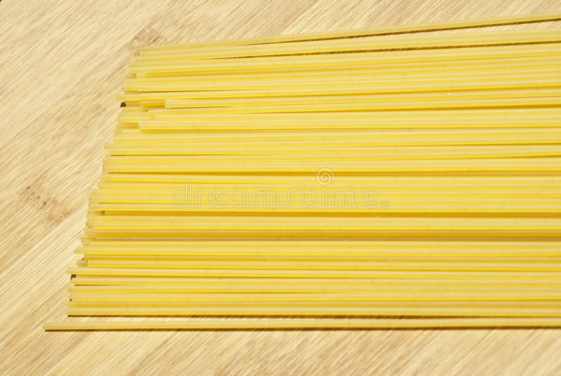 Spaghetti on wooden board