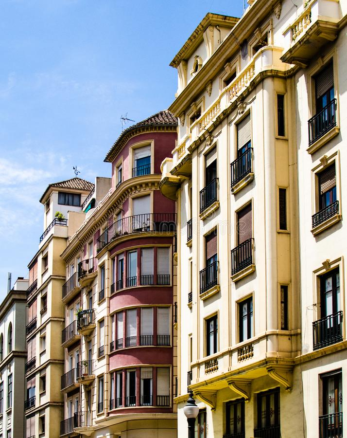 Spain, Andalusia, Granada, row of apartment buildings multicolored, wrought iron balconies. Spain, Andalusia, Granada, row of apartments, multicolored buildings stock images