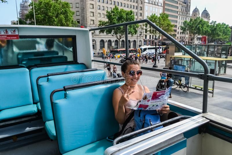 Spain Barcelona July 2017. the girl in the blue tourist bus. city tour sightseeing stock photography