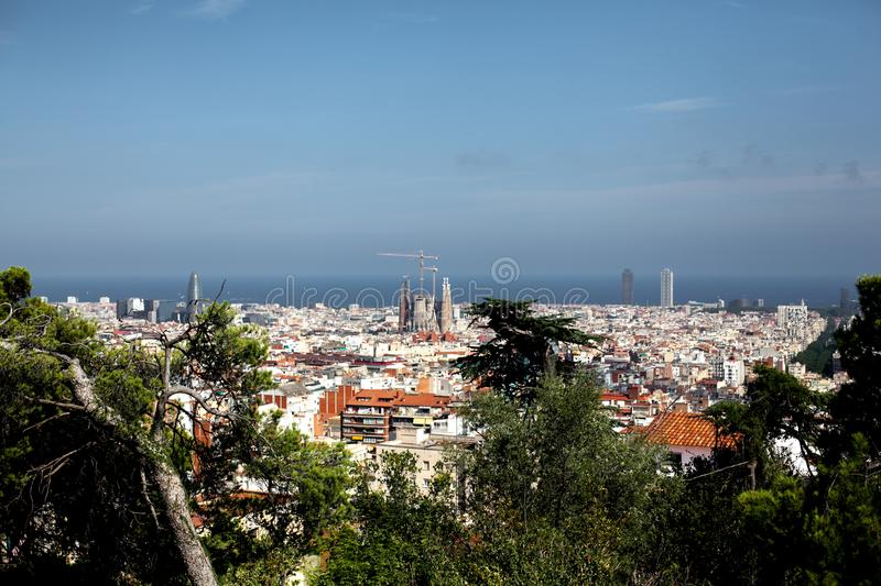 Spain, Barcelona - July 12 2018 : Top-view of skyline at sunny day from high point in park GUEL.View of the construction. Sagrada Familia and over the sea of royalty free stock image