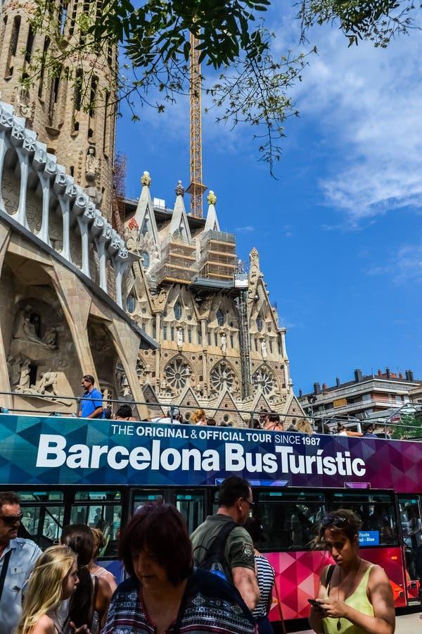 Spain Barcelona July 2017. tourist walking bus, sightseeing. Sagrada Familia royalty free stock images