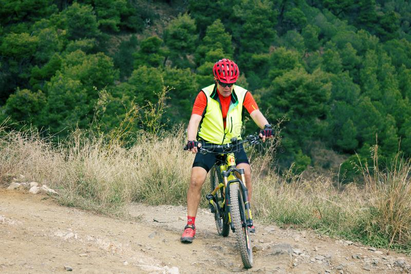 mountain bikers on mount Tibidabo for a walk on a free day stock photo