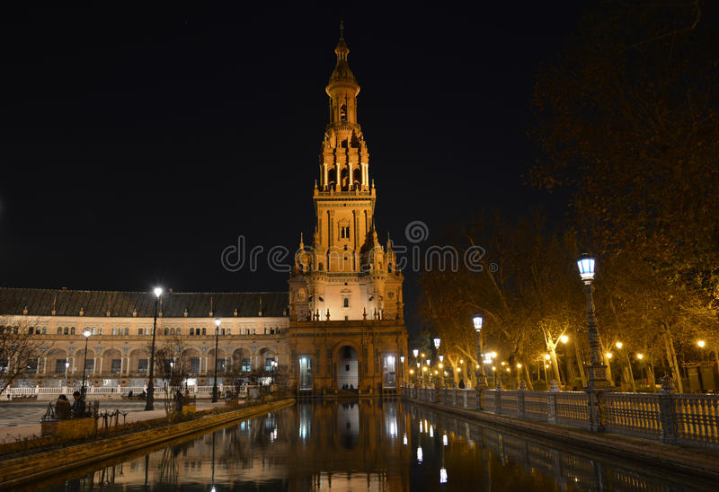 The south tower at plaza de Espana illuminated at night for Christmas, Seville. The beautiful Piazza di Spagna royalty free stock photo