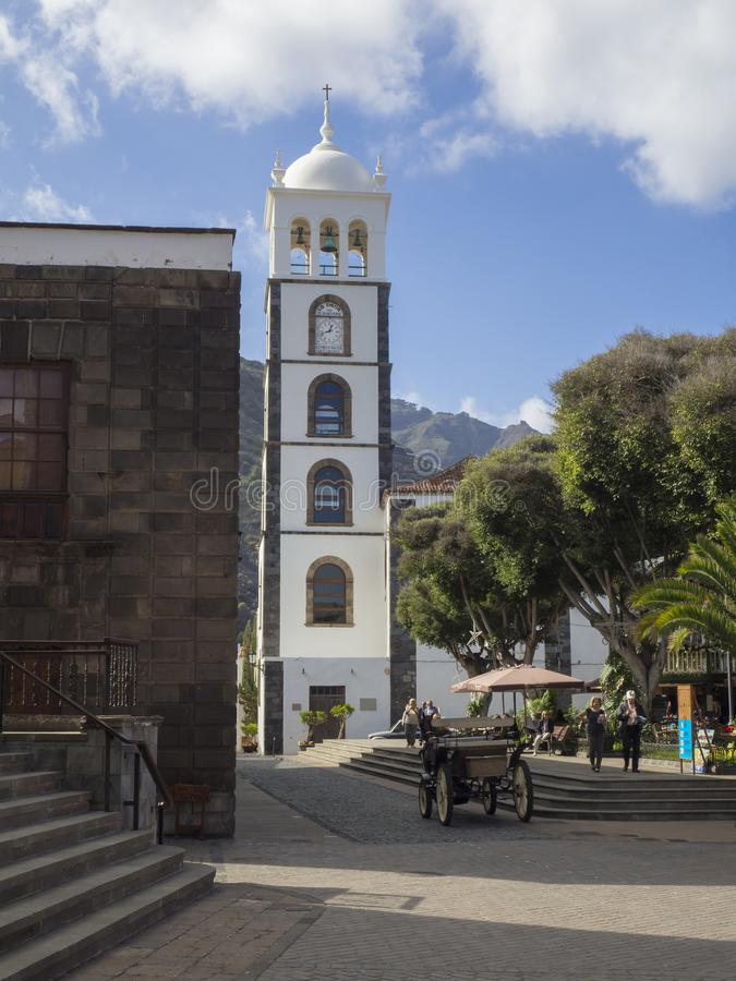 Spain, Canary islands,Garachico, December 19, main square with s. Tairs horse carriage group of tourist walking siting on the banch and relaxing with white royalty free stock image