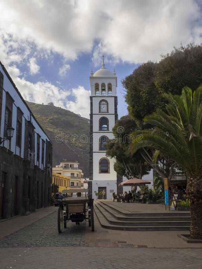 Spain, Canary islands, Garachico, December 19, 2017, main square. With stairs horse carriage group of tourist walking siting on the banch and relaxing with stock photos