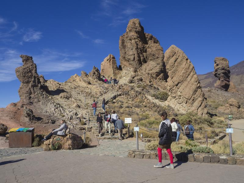 Spain, Canary islands,Tenerife, El Teide national park, December. 21, 2017, group of tourist walking on trail around Roque Cinchado in famous pitoresque rock stock photography