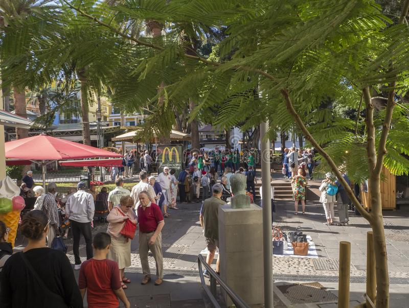 Spain, Canary islands, Tenerife, Puerto de la cruz, December 23, 2017, crowded main square walking tourist and local. People, street band playing in background stock images