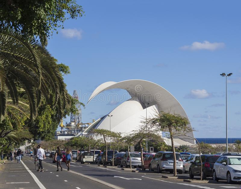 Spain, Canary islands, Tenerife, Santa Cruz de Tenerife, December 27, 2017: main street with Auditorio de Tenerife, parked. Cars, walking tourist people, palm stock photo
