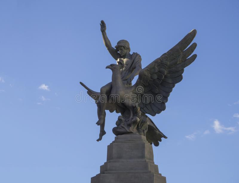 Spain, Canary islands, Tenerife, Santa Cruz de Tenerife, December 27, 2017: bronze statue of young men sitting on the giant eagle royalty free stock photography
