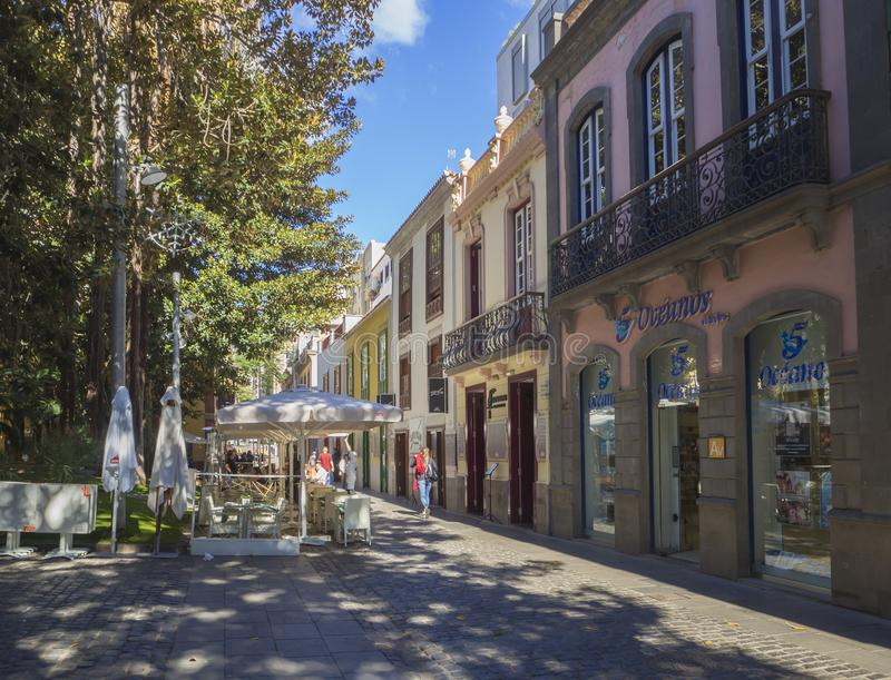 Spain, Canary islands, Tenerife, Santa Cruz de Tenerife, December 27, 2017: street in city center with old colonial style. Houses, green trees and walking stock images