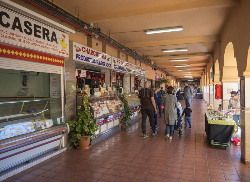 Spain, Canary Islands, Tenerife, Santa Cruz de Tenerife, December 27, 2017: people shopping in market hall, traditional. Marketplace with food stands and stock photography