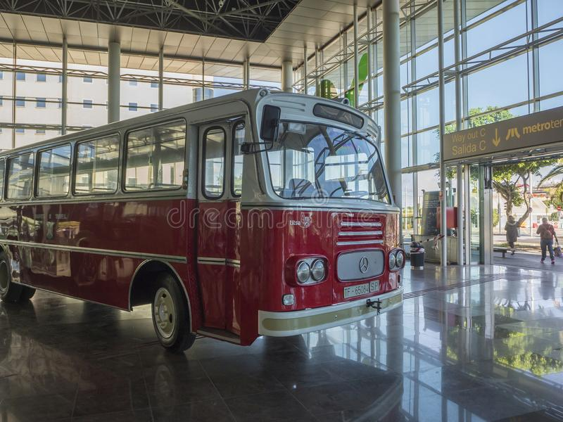 Spain, Canary islands, Tenerife, Santa Cruz de Tenerife, December 27, 2017: shiny red bus vintage veteran car mercedes placed in. Front of entrance to bus royalty free stock image