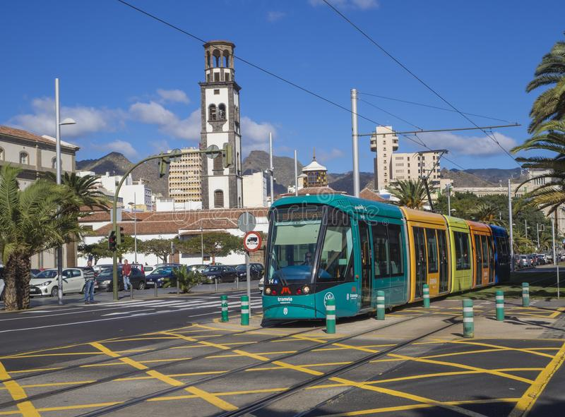 Spain, Canary islands, Tenerife, Santa Cruz de Tenerife, December 27, 2017: street in city center with tramway, cars sand white c. Hurch in sunny day stock photography