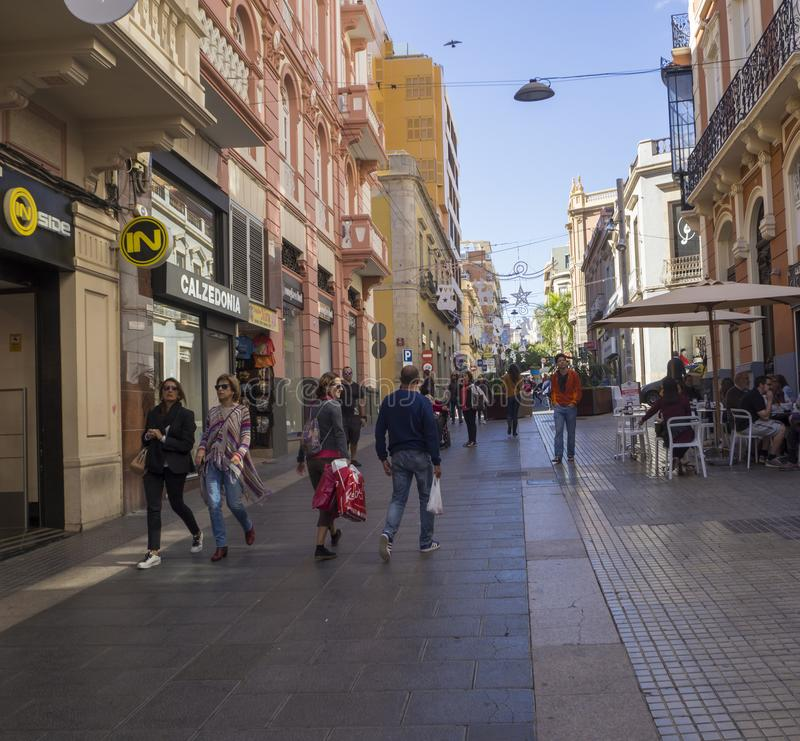 Spain, Canary islands, Tenerife, Santa Cruz de Tenerife, December 27, 2017: street in city center with old colonial style houses,. Shops and walking tourist stock image