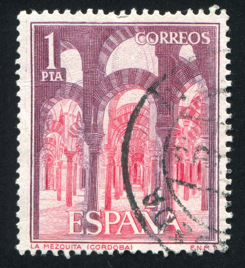 Interior of La Mezquita in Cordova. SPAIN - CIRCA 1964: stamp printed by Spain, shows Interior of La Mezquita in Cordova, circa 1964 stock image