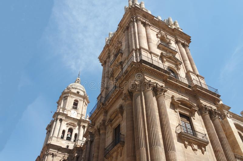 Spain, the city of Malaga.  Aview of the Cities cathedral. Spain, the city of Malaga. The ornate cathedral on a summers day. The sculptures and towers set off royalty free stock photos