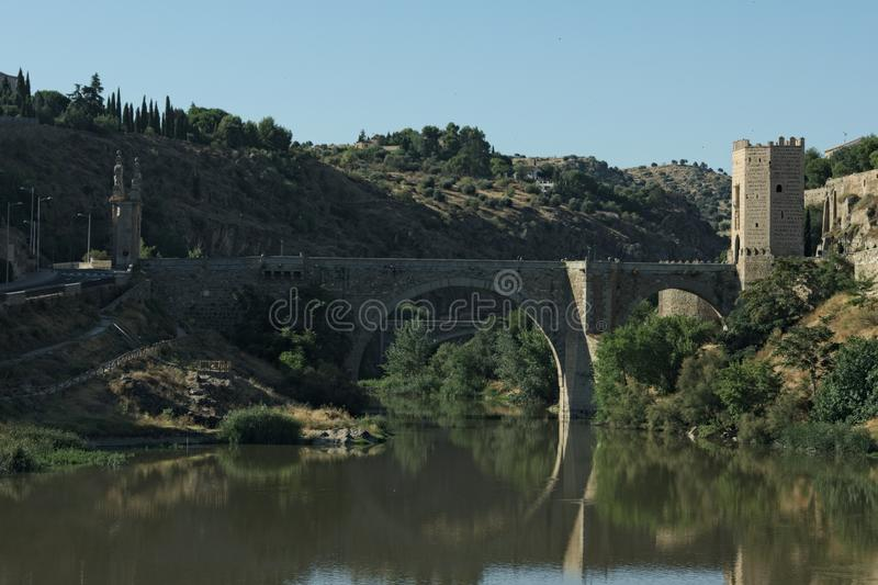 Spain the city of Toledo. A fortified medieval bridge. Spain the medieval city of Toledo. A fortified bridge into the old town which spans  the Tajo river.  The stock image