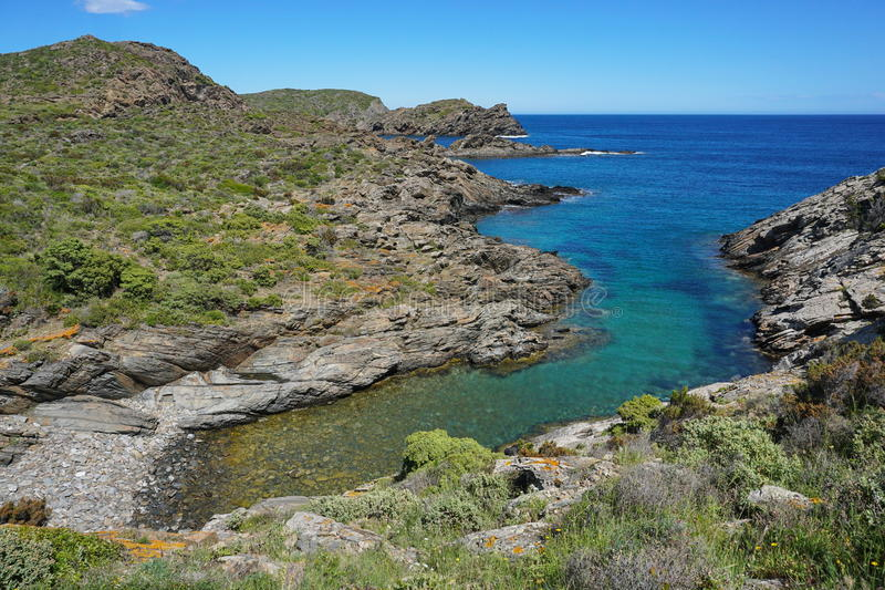 Spain Costa Brava small cove Mediterranean sea. Spain Costa Brava coastal landscape rocky shore with a small cove, Cala Torta, Mediterranean sea, Cadaques, Cap royalty free stock image