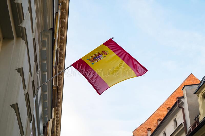 Spain flag on a building against the blue sky. Spain flag on a building against the blue sky royalty free stock images
