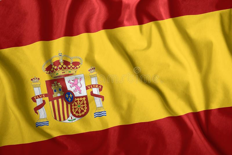 The Spain flag flies in the wind. Colorful national flag of the Spain. Patriotism, patriotic symbol.  stock photography