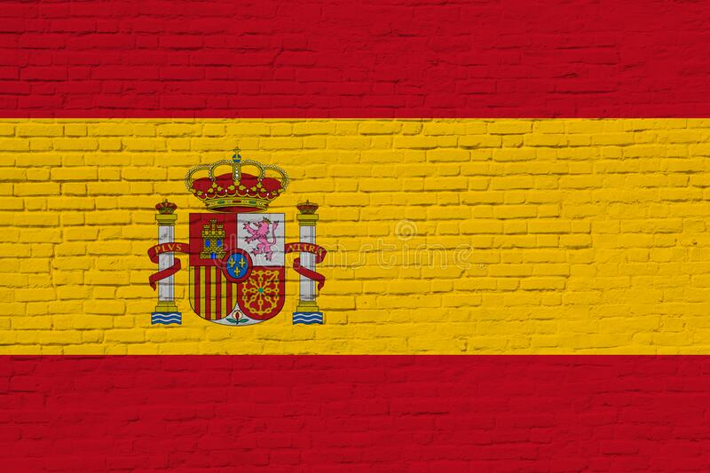 Spain flag painted on brick wall. National Spain flag painted on a brick wall close up stock photography