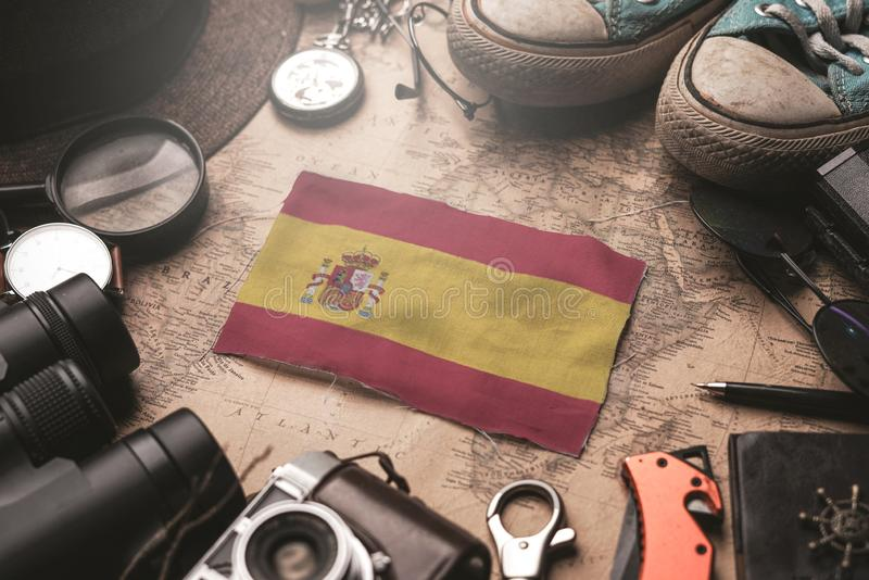 Spain Flag Between Traveler`s Accessories on Old Vintage Map. Tourist Destination Concept royalty free stock image