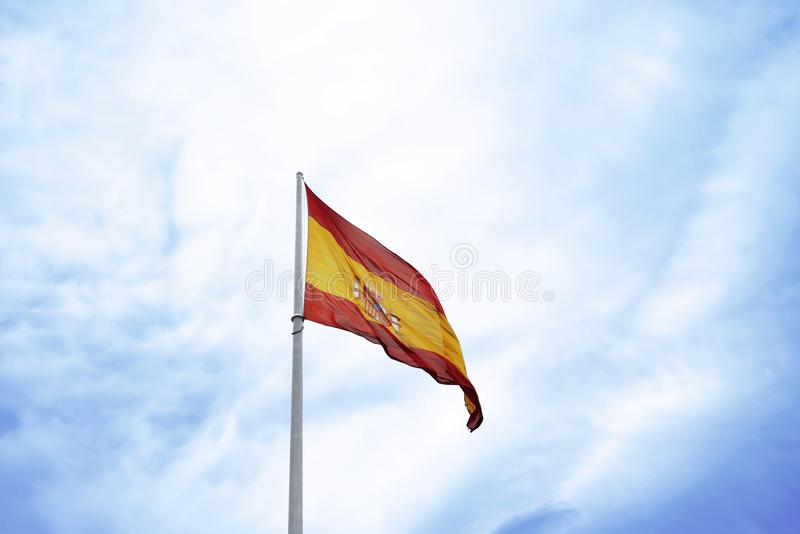 Spain Flag waving. Over blue sky background stock images